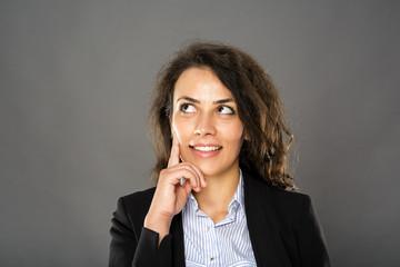 Contemplative smiling businesswoman