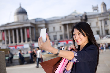 young chinese tourist taking a selfie in London