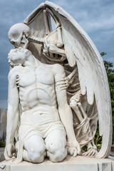 kiss of death statue at Poblenou Cemetery in Barcelona, Spain