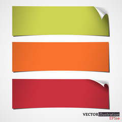 Three colored banners with curled corner. Vector illustration.