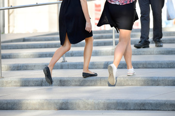 Young adult women walking up the stairs