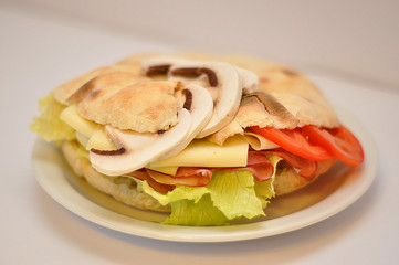sendvіch with cheese and champignons isolated in white