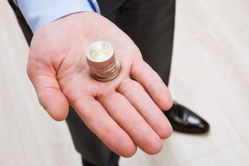 Businessman holding euro coins