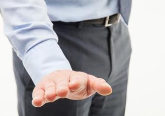 Unrecognizable businessman showing a calming gesture