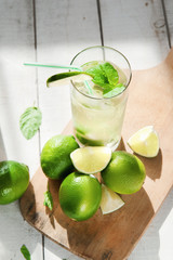 Glass of water with ice and lime