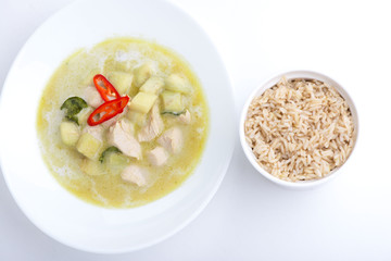Chicken green curry with rice on white