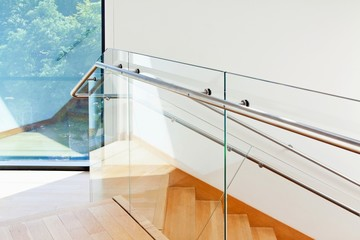 Modern architecture interior with wooden stairs