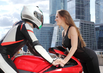 Pretty woman and motorcyclist