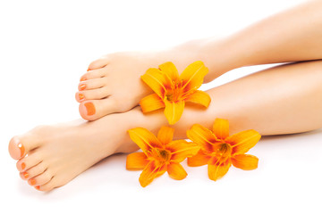 Wall Murals Pedicure Relaxing pedicure with a orange lily flower