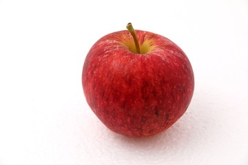 Wall Mural - Red ripe apple on white background.