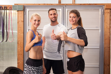 Thumbs up - fitness people showing gesture
