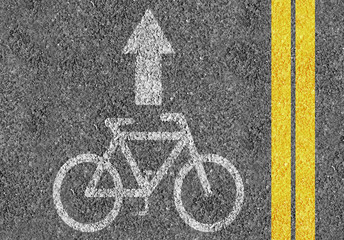 Road with bicycle lane mark and two yellow lines