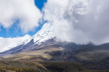 Cotopaxi Volcano top behind the clouds of the Cotopaxi National Park, Ecuador