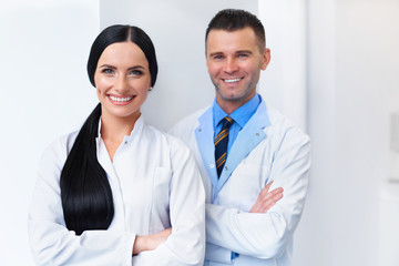 Dentist Team at Dental Clinic. Two Smiling Doctors at their Work