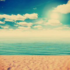 Vintage Beach and sand with white clouds blue sky