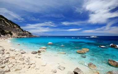 Cala Mariolu on a clear day with soft white clouds, Sardinia