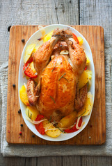 Fried whole chicken with vegetables