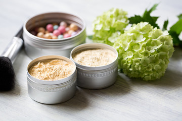 Handmade powder in metal jars