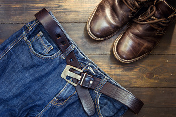 Jeans belt and shoed set on wood