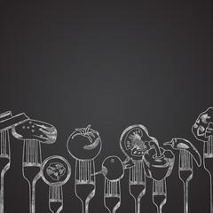 Vegetables on forks drawn on chalkboard