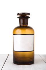 Vintage medicine bottle with blank label