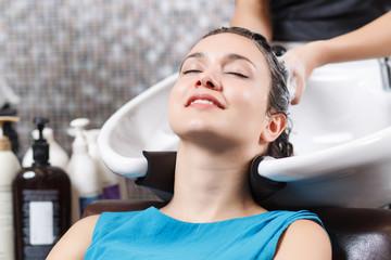 Professional hairdresser washing head