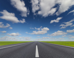 Fototapete - Road under beautiful sky between green hills