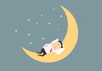 Cartoon businessman sleeping on the moon