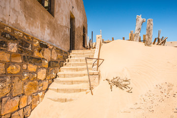 Abandoned house in   Kolmanskop, Namibia desert. It was settled by German in 1908 with a purpose of diamond searching
