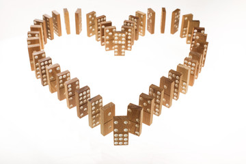 Dominoes standing in heart shape