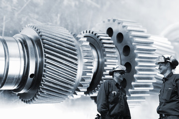 Wall Mural - engineers, workers with giant titanium cogwheels machinery, aerospace parts