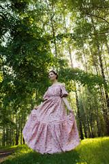 Young beautiful woman in the garden