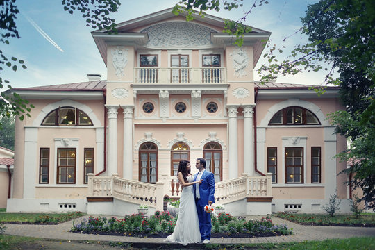 bride and groom in an old mansion