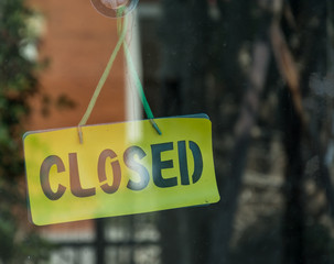The closed sign on a glass door