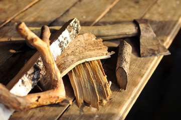 Farming tools, hammer on different types of wood  on wooden table to chop