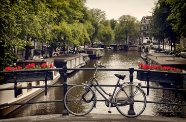 Printed roller blinds Amsterdam Bicycle Parked on the Pedestrian Bridge Overlooking a Canal in Amsterdam