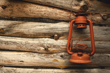 Lantern and Wooden Wall