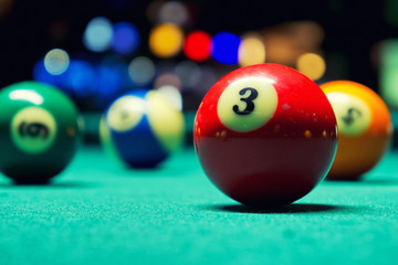 Billiard balls in pool hall