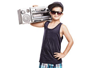 Cool boy in hip hop outfit holding a ghetto blaster