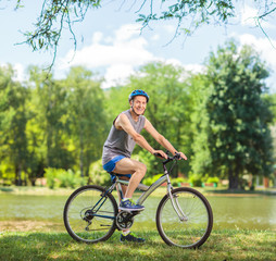 Senior biker riding a bike in park