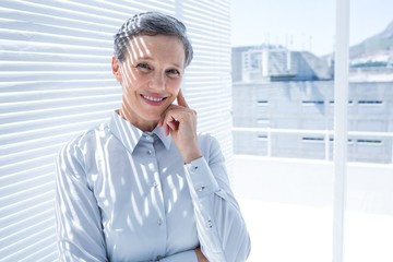 Businesswoman looking at the camera with arms folded