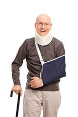 Senior man with a broken arm smiling