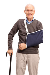 Vertical shot of a senior man with a broken arm
