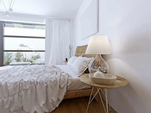 Unmade bed in bright high-tech room