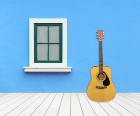 Guitar with window on cement wall
