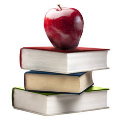 Red Shiny apple on the top of stack of colored closed books isolated