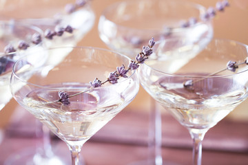 Glasses of white pink champagne decorated with lavender