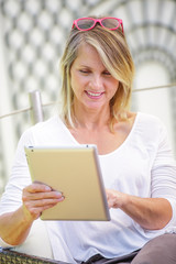 pretty woman looking at a digital tablet