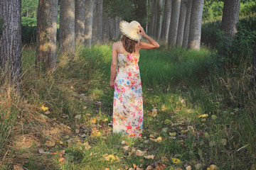 Woman with flowered dress and summer hat