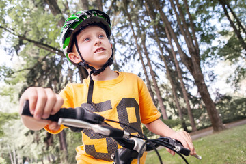 Boy in safe helmet ride a bicycle